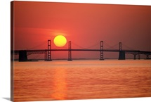 View from the water of the Chesapeake Bay Bridge and the setting sun, Maryland