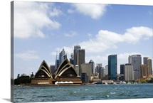 View of the Opera House and downtown Sydney from across the harbor