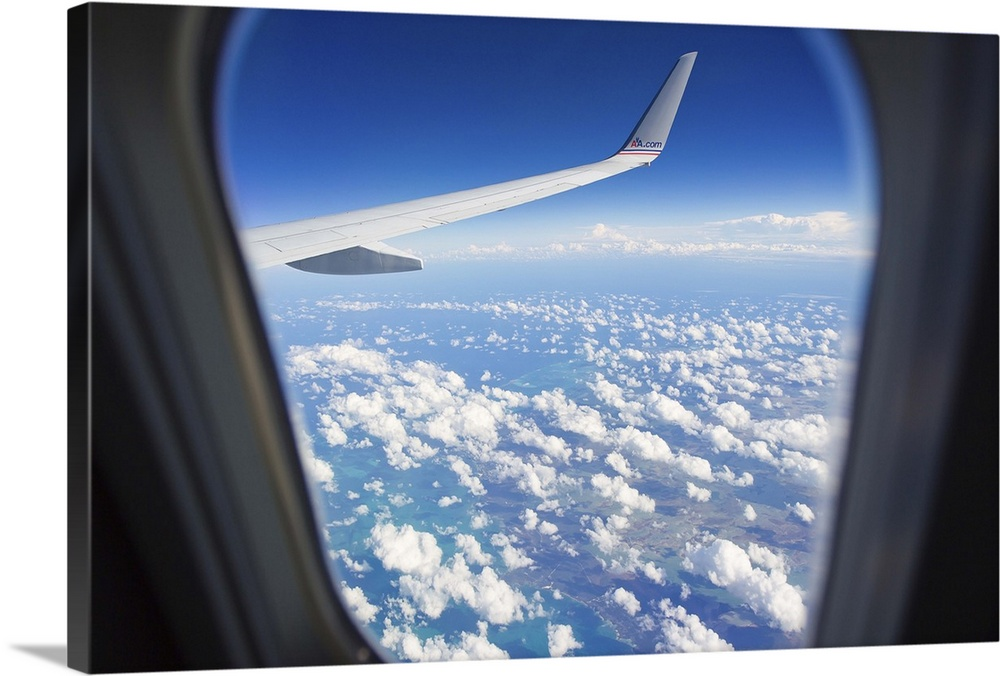 View Through A Passenger Airplane Window Flying Over The Caribbean