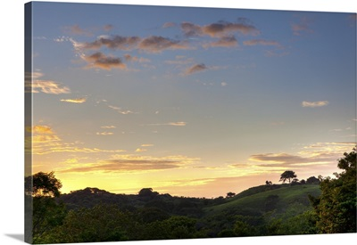 Sunset over jungle clearing