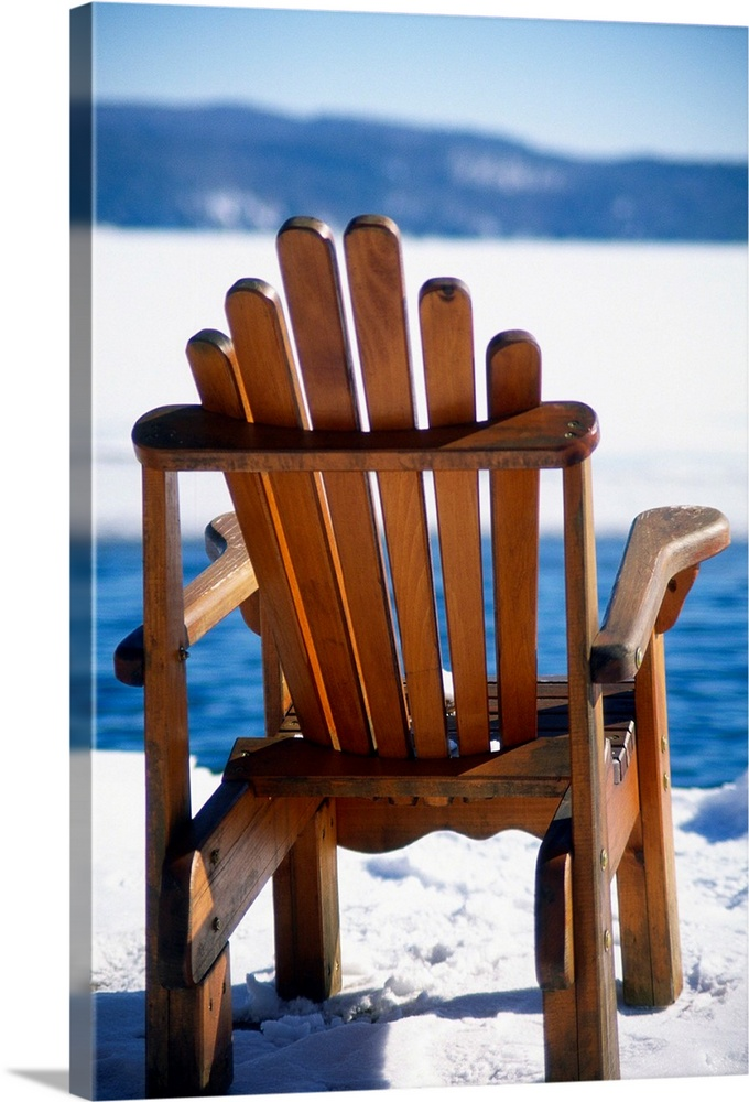 Empty Adirondack Chair On The Deck In Winter, Lake George, New Y