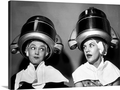 1950s Two Women Sitting Together Gossiping Under Hairdresser Hair Dryer