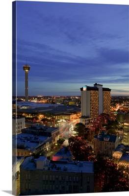 Aerial view of buildings lit up at dusk, San Antonio River Walk, San Antonio, Texas