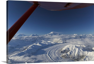 Aerial view of snow covered mountains on a polar landscape, Mt Mckinley, Denali National Park, Alaska