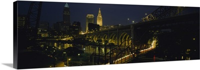 Arch bridge and buildings lit up at night, Cleveland, Ohio