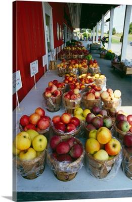 Baskets of harvested apple varieties, farmers market.