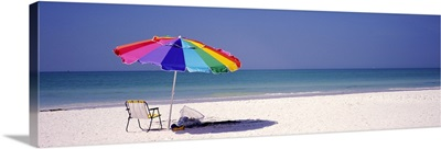 Beach umbrella and a folding chair on the beach, Fort De Soto Park, Tierra Verde, Florida