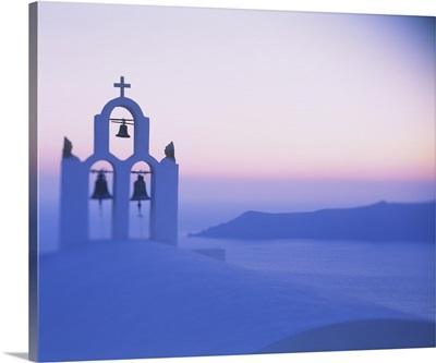 Bell tower of a church at sunset, Santorini, Greece