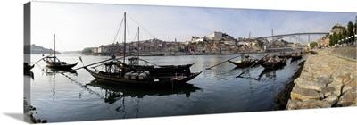 Boats in a river Dom Luis I Bridge Duoro River Porto Portugal