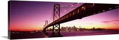 Bridge across a bay with city skyline in the background, Bay Bridge, San Francisco Bay, San Francisco, California,