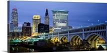 Bridge in a city lit up at dusk, Detroit Avenue Bridge, Cleveland, Ohio