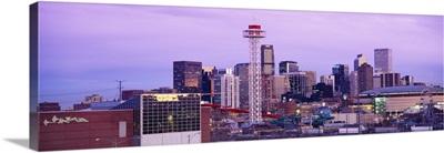 Building lit up at dusk, Denver, Colorado