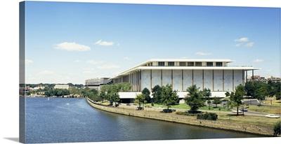 Buildings along a river, Potomac River, John F. Kennedy Center for the Performing Arts, Washington DC