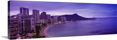 Buildings at the coastline with a volcanic mountain in the background, Diamond Head, Waikiki, Oahu, Honolulu, Hawaii