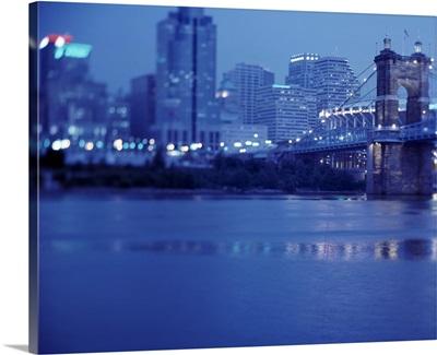 Buildings at the waterfront lit up at dusk, Cincinnati, Hamilton, Ohio