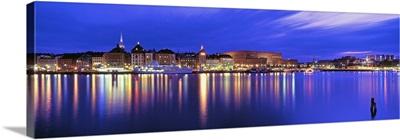 Buildings at the waterfront lit up at dusk, Stockholm, Sweden