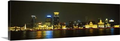 Buildings at the waterfront lit up at night, Pudong, Huangpu River, Shanghai, China