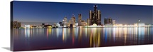 Buildings in a city lit up at dusk, Detroit River, Detroit, Michigan,