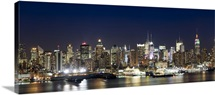 Buildings in a city lit up at dusk, Hudson River, Midtown Manhattan, Manhattan, New York City, New York State,