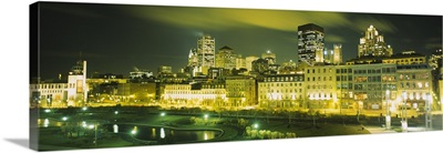 Buildings in a city lit up at night, Auberge Du Vieux Port, Montreal, Quebec, Canada