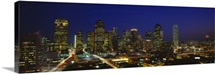 Buildings in a city lit up at night Dallas Texas