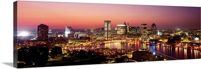 Buildings lit up at dusk, Baltimore, Maryland