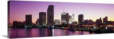 Buildings lit up at dusk Biscayne Bay Miami Miami Dade county Florida