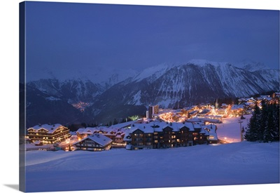 Buildings lit up at dusk, Courchevel, French Alps, France