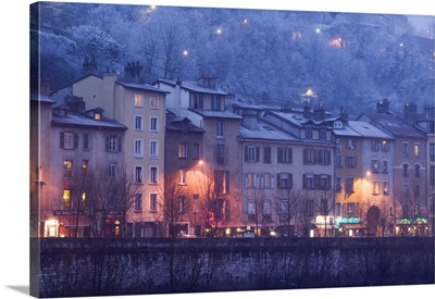Buildings lit up at dusk, Isere River, Grenoble, French Alps, France