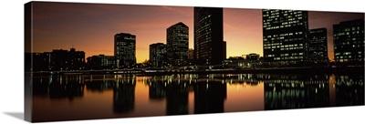 Buildings lit up at dusk, Oakland, Alameda County, California,
