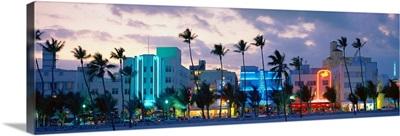 Buildings lit up at dusk, Ocean Drive, Miami Beach, Florida