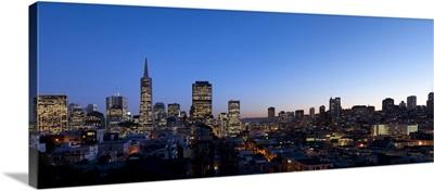 Buildings lit up at dusk, Telegraph Hill, San Francisco, California