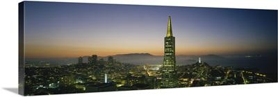 Buildings lit up at dusk, Transamerica Pyramid, San Francisco, California