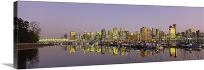 Buildings lit up at dusk, Vancouver, British Columbia, Canada