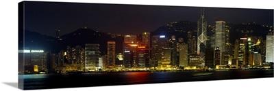 Buildings lit up at night, Hong Kong, China