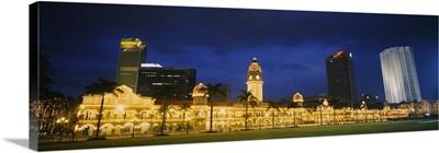 Buildings lit up at night, Kuala Lumpur, Malaysia