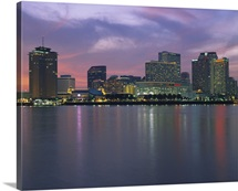 Buildings lit up at sunset, New Orleans, Louisiana