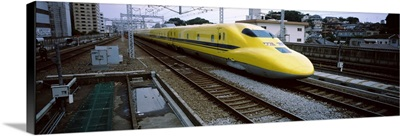 Bullet train moving on railroad track, Shin Yokohama Station, Yokohama