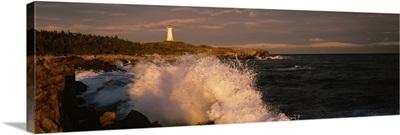 Canada, Nova Scotia, Cape Breton Island, Waves breaking on the rocks near Louisbourg lighthouse