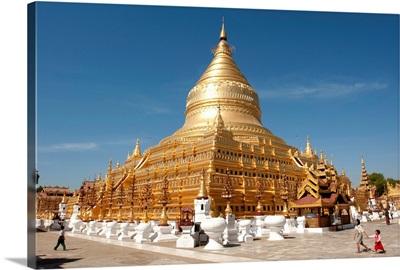 Children walking in front of a temple, Shwezigon Pagoda, Bagan, Mandalay, Myanmar