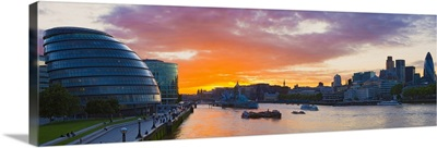 City hall with office buildings at sunset Thames River London England