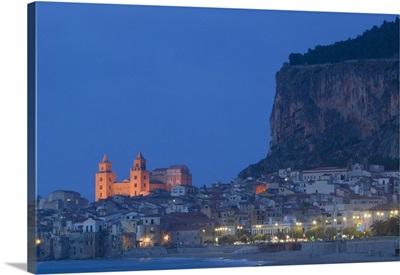 City lit up at dusk, Cefalu, Sicily, Italy