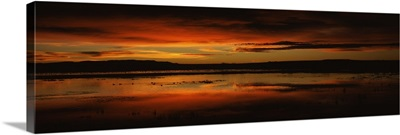 Clouds over a lake Bosque del Apache National Wildlife Refuge Socorro County New Mexico
