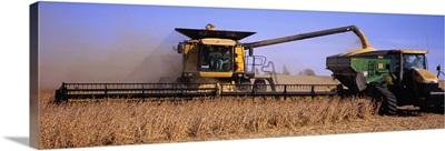 Combine harvesting soybeans in a field, Minnesota