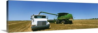 Combine in a wheat field, Kearney County, Nebraska