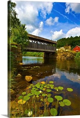 Covered bridge across a river, Vermont
