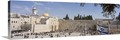 Crowd praying in front of a stone wall Wailing Wall Dome Of The Rock Jerusalem Israel