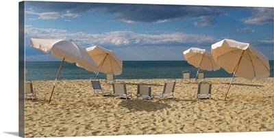 Deck chairs and beach umbrellas on the beach, Jetties Beach, Nantucket, Massachusetts