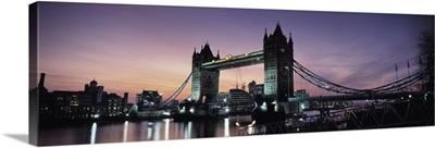 Drawbridge lit up at dusk Tower Bridge Thames River London England