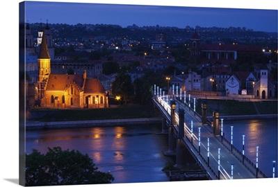 Elevated view of Vytautas Church and Aleksoto tiltas bridge at dusk, Kaunas, Lithuania